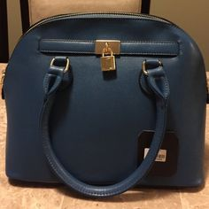 Brand New Bright Blue Large Purse Bright blue purse NWT! The stuffing is still in it! It has a locker on the front, zipper on back, and zipper pockets inside. Due to size and weight this item can't be bundled. Bags Satchels