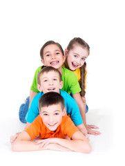 Five beautiful kids lying on the floor.