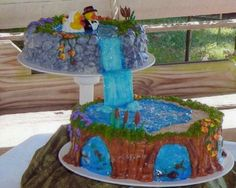 Waterfall wedding cake (no fondant) the fish are fruit roll up.
