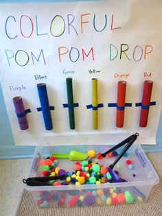Colorful Pom Pom Tube drop activity. Great for color matching and fine motor development. They could even use tweezers to pick up and place the pom poms for more fine motor exercise.