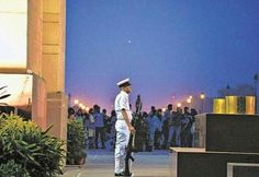 In safe hands  	   TIGHT VIGIL: A Navy officer guards the 'Tomb of the Unknown Soldier' at India Gate in New Delhi on Friday. — PHOTO: AFP