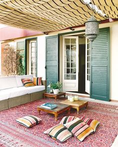 For underneath the deck, I like the shutters flanking the door. The more stuff to cover up that ugly cinder block, the better.