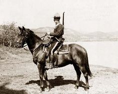 photo of Royal Canadian northwest mounted policemen on horseback, Dawson, Yukon Territory, Canada.  It was made in 1917