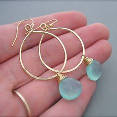 "Hand-hammered hoops and natural chalcedony stone charms wrapped in 24-karat gold wire  1.4"" Wide x 2.5"" Drop -- Avoid contact with all oils, beauty products and sweat. Clean with a soft dry cloth."