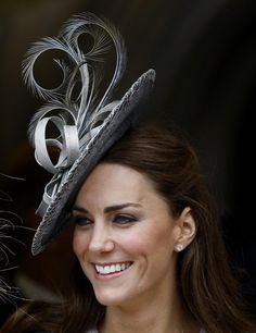 Catherine, Duchess of Cambridge watches the procession pass at the Order of The Garter Service in Windsor.