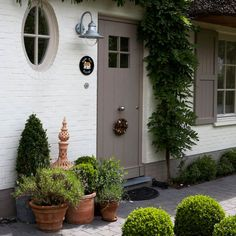 white house, gray shutters: Ok so it's exterior not interior, but where else to pin it! Exterior Paint Colors, Exterior House Colors, Exterior Design, Exterior Shutters, Painted Brick Exteriors, Front Door Colors, House Front, House Painting, Beautiful Homes