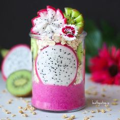 Dragon fruit Nicecream Parfait  How gorgeous is the colour of Dragon fruit / Pitaya!?  I used @just blends 100% Freeze Dried Dragon Fruit Powder to get the gorgeous colour  Layered with @tableofplenty Nicely Nutty muesli, plain oats, kiwi and topped with dragon fruit and kiwi flowers  what a perfect meal in a cup  Expect to see lots of dragon fruit inspired smoothie bowls and chia puddings coming up  Thanks again to everyone that has entered my #JoShareTheLove party so far. You guys just…