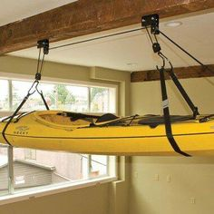 The Sherpak Hoist is an all-purpose garage storage solution. This heavy-duty hoist will also lift bikes or storage boxes right to the ceiling of your garage. Built with heavy-duty pulleys and rope, this hoist is capable of lifting one hundred pounds. Kayak Storage Rack, Shed Storage, Storage Spaces, Storage Boxes, Kayak Garage Storage, Garage Hoist, Fishing Storage, Kayak Rack, Hanging Storage