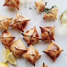 Mini Spinach-and-Herb Pies   Serve some of these delicious finger food recipes at your next party. Get all the recipes at Food & Wine.