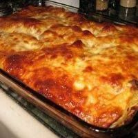 · 7 oz. pkg. thin spaghetti noodles · 1 tsp. butter · 1 1/2 lbs. ground beef · salt and pepper · 1 tsp. minced green pepper · 8 oz. pkg. cream cheese · 1/4 c. sour cream · 8 oz....