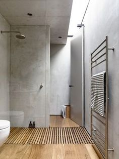 Beautiful modern bathroom design with timber shower base and concrete walls. Love the palette chosen for this design.