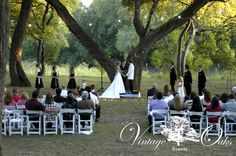 Small outdoor wedding. Classic black and white decor. Ceremony under big oak tree. Vintage Oaks Events www.vintageoaksevents.com