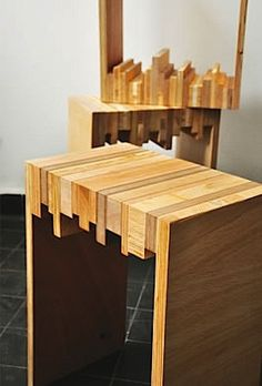 Modern D.I.Y. end tables from wood scrap. THIS IS SO CLEVER! I LOVE THE DIFFERENT SIZES OF THE PIECES OF WOOD USED FOR THE TOP!