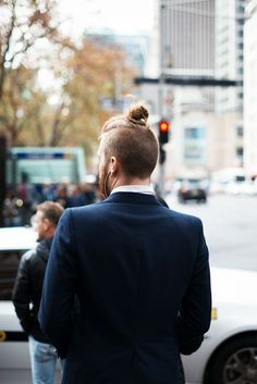 The man bun Undercut hairstyle is a spin-off of the slicked back Undercut. As you can see in the picture of a man bun Undercut, the hair is buzzed very short as per the regular Undercut haircut while Top Hairstyles For Men, Hipster Haircuts For Men, Popular Mens Hairstyles, Hipster Hairstyles, Undercut Hairstyles, Cool Haircuts, Woman Hairstyles, Man Bun Undercut, Mohawk Ponytail