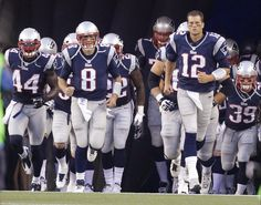 New England Patriots quarterback Tom Brady (12) leads his team out onto the  field 5e81d31a7c6b