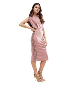 Just because it's the holidays doesn't mean your sartorial options are limited to ornament hues like silver and gold (or red and green for that matter). Bejeweled trim adds seasonally-appropriate appeal to this dusty rose number.