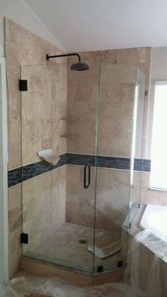 Call Cut Rate Glass for all your custom frameless glass needs. This is a 3/8 frameless enclosure. Notice the mitre cut and the 135 angle where the door meets the side panel makes this shower glass enclosure very unique. 702-292-9977