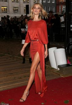 Best leg forward: Model and actress Rosie showed off her amazing body and her metallic hee...