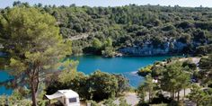 This is Coteau de la Marine in Provence, France.  The campsite lies next to the Gorges du Verdon.  Imagine waking up each morning and taking a stroll by the deep blue streams!