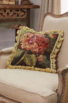 With a fun tassel fringe and beautiful hand-crafted needlepoint, our Hydrangea Aubusson Pillow is backed with cotton velvet. I