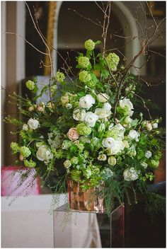 An Heirloom Wedding. Large-scale arrangement using blooming branches and foliages