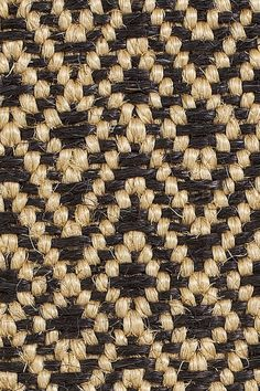 "Discovered the Merida ""Dune"" sisal rug in Black at the office today. I'm obsessed!!! It would look gorgeous with neutrals."