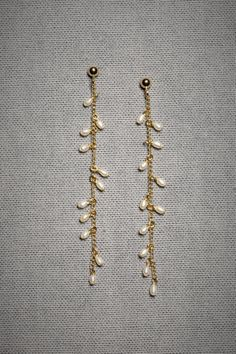 The quiet sweetness of these delicate seed pearl earrings appeals to me. The fact that they would move with the shake of a head gives them a very natural quality that most jewelry - by its very artfulness - lacks.