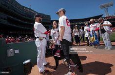 Dustin Pedroia of the Boston Red Sox talks with Boston Marathon... News Photo   Getty Images