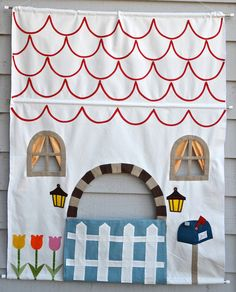 I think it would be fun to make house fronts for the kids' bedroom doors.
