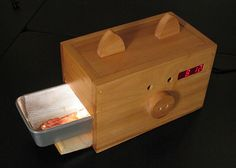 From the site: Alarm clock wakes you to the smell of cooking bacon.  Absolute freakin' genius.  (but a wee bit o' fire hazard, perhaps?)