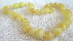 Milk & Butter color Inspired By Finn Baltic Amber Teething Necklace. It has made such a huge difference w/teething. Chayse never goes without it.