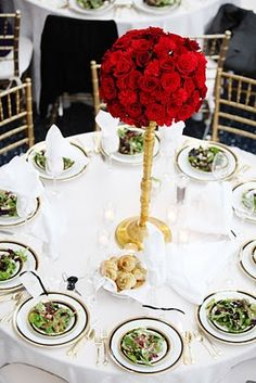 Bella Fiori - Classic centerpiece, roses and carnations on a gold candelabra.