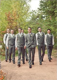 Grey vests and pants, white button down shirts paired with green plaid ties, black shoes, and white rose boutonnieres. Wedding styles: rustic, vineyard; Wedding colors: green and grey. Photo by Carlie Statsky, check out more here.