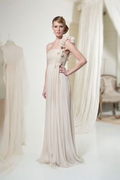 A one shoulder chiffon wedding dress with so much flow and movement by Leila Hafzi