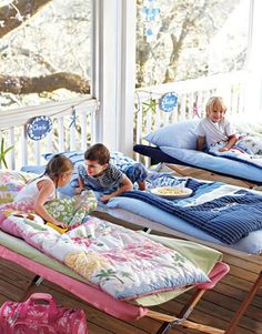 When you're planning a sleepover in the summer, let the kids sleep on a deck or screen porch if you have one. A few old-fashioned cots are easy to store and set up, and in combination with a sleeping bag for each child they're perfectly cozy. We gave this party a beachy theme by labeling each cot with a sign decorated with shells, strung along a garland with colorful starfish.