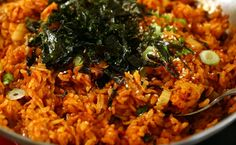 Kimchi Fried Rice Super easy and super cheap.  You could also add a fried egg on top or some cheese. It goes over really well.