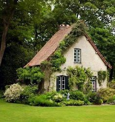 A storybook cottage wants a palette of earthy tones as creams, browns, rusts and other colors that tie the house to the ground. Whether introduced in the landscaping or as accents in the architecture, these colors keep the house from… Continue Reading → Storybook Homes, Storybook Cottage, Cute Cottage, Cottage Style, Cottage Living, Cottage Homes, Country Living, Fairytale Cottage, Cottage Gardens