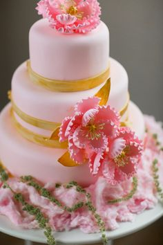 Pink and gold three-tiered wedding cake