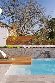 Aloha Pools Pty Ltd designed this courtyard pool in Balwyn, Victoria, Australia. Textural diversity and a subdued, elegant planting scheme create beautiful contrasts for this pool and surrounding yard.