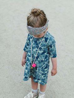 printed dress, head scarf and fluo necklace.  #designer #kids #fashion  www.kidsfinest.nl