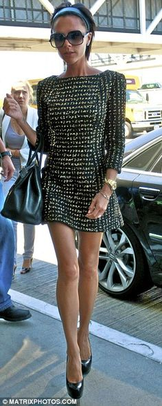 Victoria Beckham in Victoria Beckham Fall 2009 collection, Hermes Birkin bag, and Trib Two pumps, August 2009