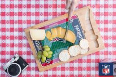 The ultimate spread? Bring your New England Patriots cutting board to the next picnic, and don't forget your favorite cheese.