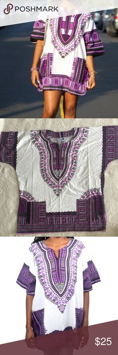 White/Purple Dashiki 100 cotton!  Made in Thailand, however purchased in Nigeria and 100% authentic! (Super popular in W. Africa and abroad) This dashiki is unisex and one size fits most. Therefore it will be an oversized style for those who are extra small to medium! Pair it with a belt, over the knee boots, wear it as a top, a dress, or a tunic. (Perfect for men too!) So many style options!  Length: 29.5 inches and bust: 59 inches  No trades, please! 0001181700ng dashiki Tops