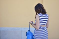 Errand-running outfit - midilema (midilema.com) Lucía Peris is wearing striped asymmetric dress, Coach blue backpack, Topshop cat eye sunglasses, Aristocrazy watch and ring, and Adidas Superstar sneakers.