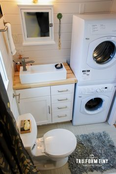 A 28 luxury tiny house built by TruForm Tiny in Nevada. by chrystal The post A 28 luxury tiny house built by TruForm Tiny in Nevada. by chrystal appeared first on Decoration. Tiny House Bathroom, Laundry In Bathroom, Tiny Bathrooms, Two Bedroom Tiny House, Bathroom Cabinets, Bathroom Faucets, Bathroom Mirrors, Laundry Rooms, Bathroom Storage
