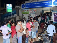 people withdrawing money at atms