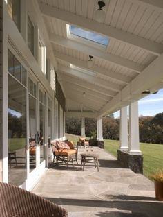 Transom windows and skylights in ceiling of covered deck or porch allow so much more light inside