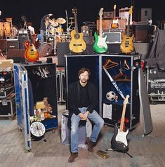 Guitarist Eric Clapton with large packing cases and a selection of his guitars while on tour circa 1990