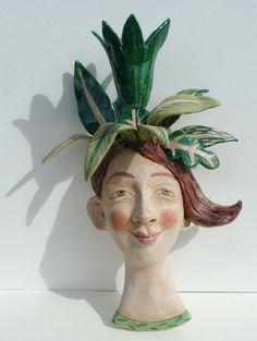 green - head - woman with leaves - figurative ceramic -  Helen Kemp