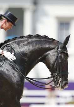 Anky van Grunsven of the Netherlands riding Salinero comforts her horse after the equestrian Dressage Individual Grand Prix Freestyle at the London 2012 Olympic Games August 9. #dressage #top riders